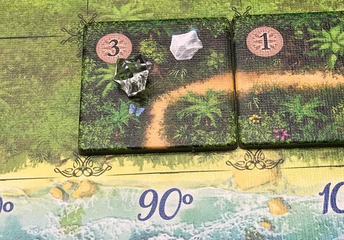 Spieletipp: Karuba von HABA, Kristall auf Dschungelplättchen legen